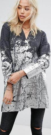 oversized jumper with metallic paint and cable knit