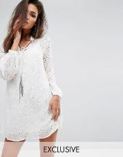 relaxed smock dress in sheer fabric with chain tassel ties