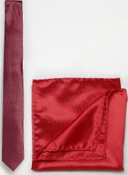 red plain tie and pocket square