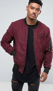 bomber jacket in burgundy faux suede