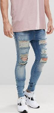 muscle fit drop crotch jeans with distressing