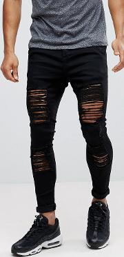 muscle fit jeans in black with distressing