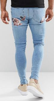 muscle fit jeans with floral embroidery