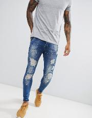 skinny fit low rise jeans with paint splat  dark blue