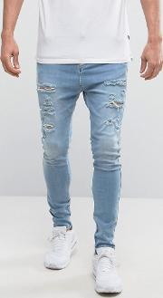 super skinny jeans  light wash with distressing and zips