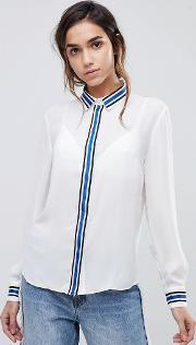 blouse with contrast colour trims