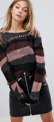 wide neck distressed jumper with glitter detail