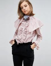 blouse with ruffles and shoulder details