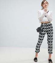 cigarette trousers with front stripe in all over llama print