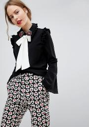 contrast pussybow blouse with embellished broach collar