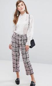 cropped trousers in tweed check