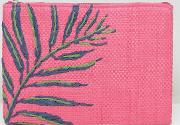 hot pink straw clutch bag with palm embroidery