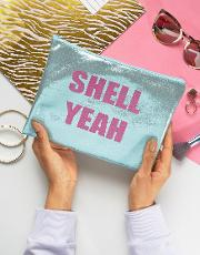 shell yeah metallic blue pouch