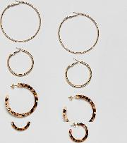 set of 4 gold and carey earrings