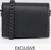 minimal cross body with whipstitch strap  black