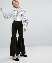 kick flare trousers with front split