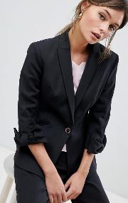 tailored blazer with bow cuff