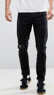 Riley Skinny Fit Ripped Black Jeans