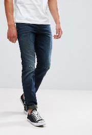 regular fit jeans in dark wash with abrasions