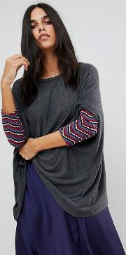 slouchy jumper with embroidered detail