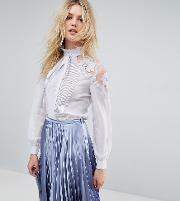 premium blouse with lace insert and tie neck detail