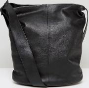 minimal leather shoulder bag with cross body strap