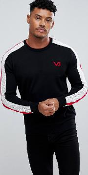 jumper in black with red sleeve stripe