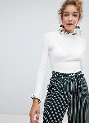 flared sleeve and high neck contrast trim jumper