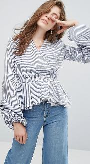 Wrap Front Blouse With Exaggerated Sleeves