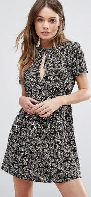 paradise lost daisy printed tea dress with capped sleeves and keyhole front