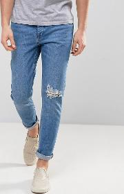 mid indigo wash skinny jeans with unrolled hems