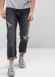 ripped skater fit jeans in washed black